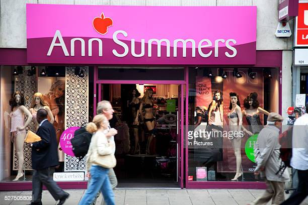 Shoppers pass by Ann Summers adult store on Oxford Street in Central London This is a busy shopping area full of all the main high street chain stores