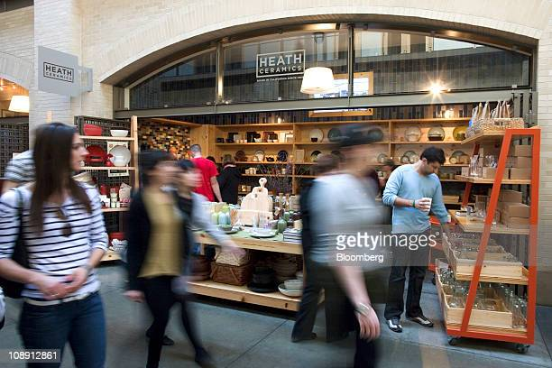 Shoppers pass by the Heath Ceramics Ltd store at the Ferry Building in San Francisco California US on Saturday Feb 5 2011 Robin Petravic and his wife...