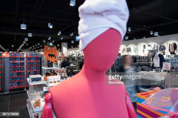 Shoppers pass clothing and a festive Halloween pumpkin themed display inside a Hema BV store in Tilburg Netherlands on Wednesday Oct 4 2017...