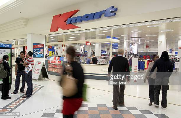 Shoppers pass in front of a Kmart store in Perth Australia on Monday July 26 2010 Wesfarmers Ltd Australia's secondlargest retailer said sales at its...
