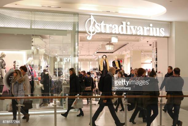 Shoppers pass in front of a Stradivarius fashion clothing store during Black Friday sales at the Vegas shopping mall in Moscow Russia on Friday Nov...