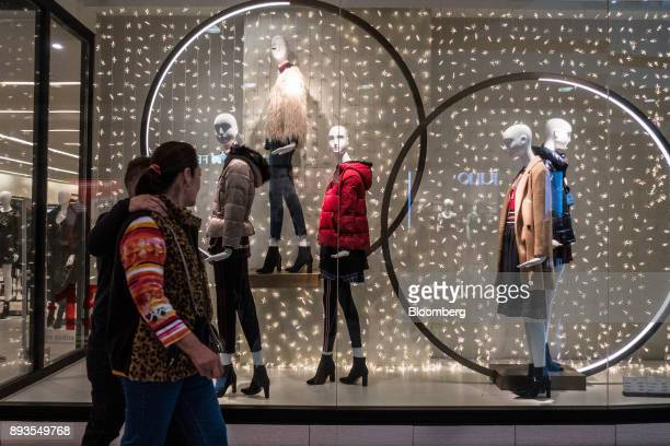 Shoppers pass in front of a Zara fashion store operated by Industria de Diseno Textil SA at the Forum Buenavista mall in Mexico City Mexico on Monday...