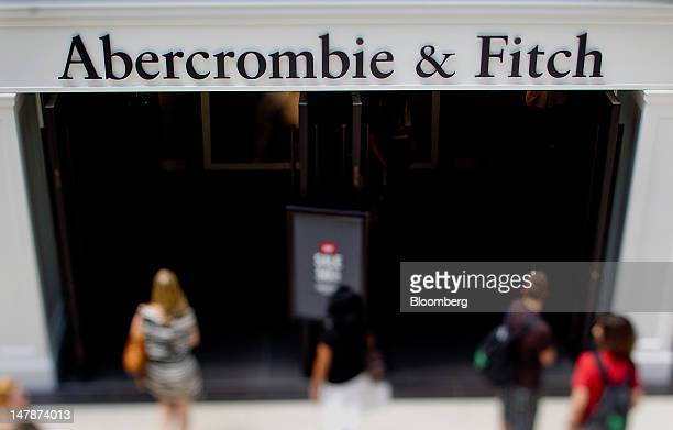 Shoppers pass in front of an Abercrombie Fitch Co store in this photo taken with a tilt shift lens at Eaton Centre in Toronto Ontario Canada on...