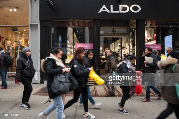 Shoppers pass in front of an Aldo Group Inc store in the SoHo neighborhood of New York US on Friday Feb 9 2018 Bloomberg is scheduled to release...