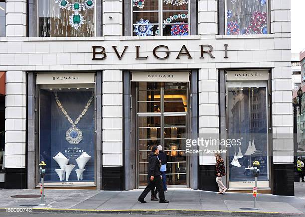 Shoppers pass in front of the Bulgari store in San Francisco's upscale Union Square shopping district. The store is noted for its Italian jewelry and...