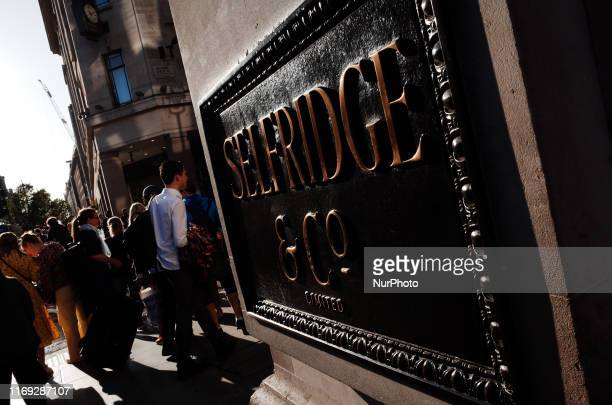 Shoppers pass Selfridges department store on Oxford Street in London, England, on September 18, 2019. UK retail sales figures covering the month of...