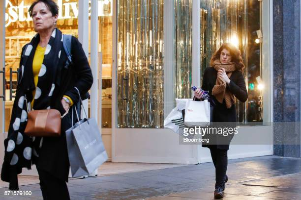 Shoppers pass Stradivarius fashion clothing store while walking along on Oxford Street in central London UK on Tuesday Nov 7 2017 UK retail sales...