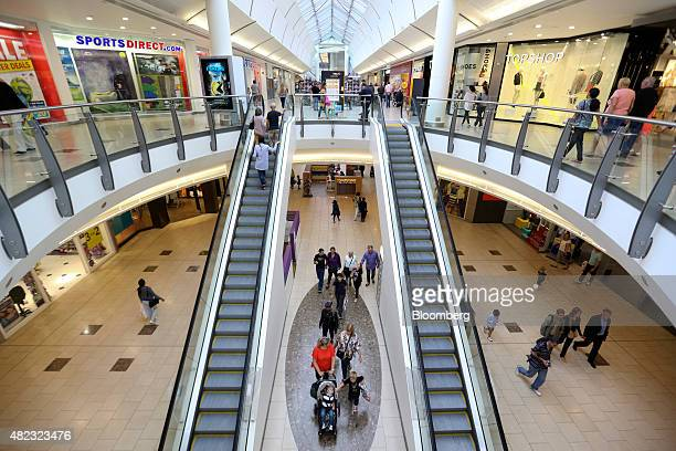 Shoppers pass through Lakeside shopping centre, operated by Intu Properties Plc., in Thurrock, U.K., on Wednesday, July 2015. U.K. Economic growth...