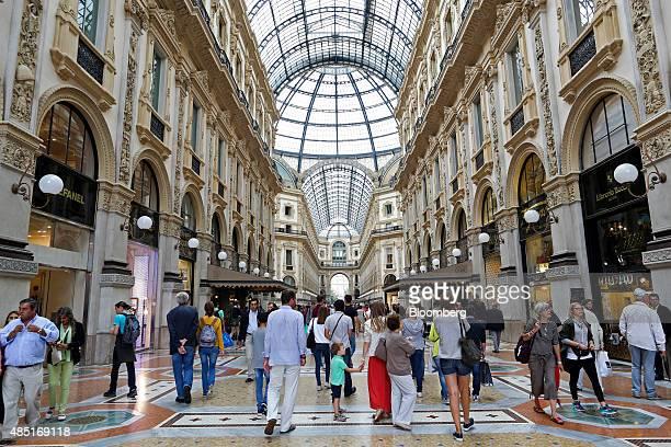 Shoppers pass through the Galleria Vittorio Emanuele shopping mall in Milan Italy on Monday Aug 24 2015 The Italian economy grew less than forecast...