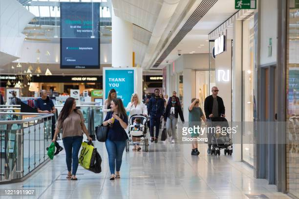 Shoppers pass through the Lakeside shopping centre, operated by Intu Properties Plc, in Thurrock, U.K., on Friday, June 19, 2020. U.K. Retail sales...