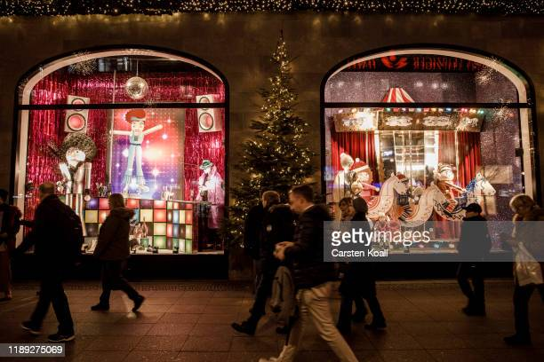 Shoppers passing the KADEWE department store at the Kurfuerstendamm in the final days before Christmas on December 17 2019 in Berlin Germany...