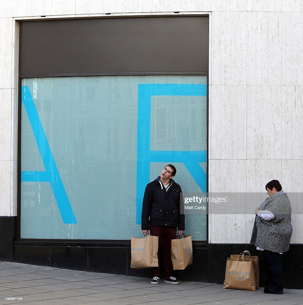 Shoppers pause outside a shop on December 10, 2012 in Bristol, England. With internet shopping still on the rise, many traditional retailers claim this Christmas could be the one that will determine the future of the high street.