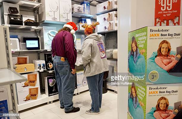 Shoppers peruse items at a Brookstone at the North County Fair Mall on November 27 2015 in Escondido California Although Black Friday sales are...