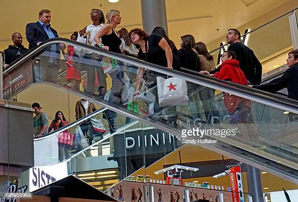 Shoppers peruse items at the North County Fair Mall on November 27 2015 in Escondido California Although Black Friday sales are expected to be strong...