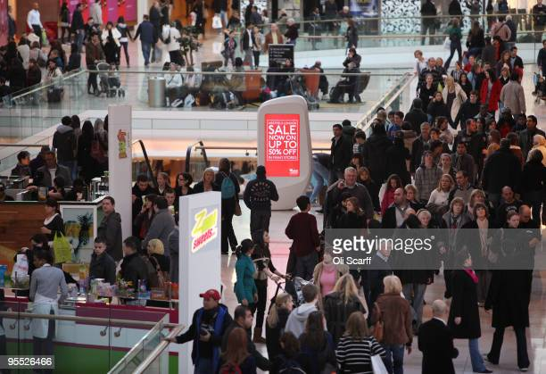 Shoppers peruse the sales in the giant Westfield shopping centre on January 2 2010 in London England High street retailers have reported better than...