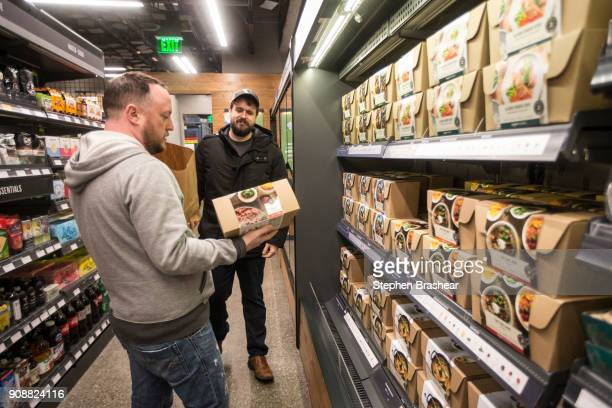 Shoppers Peter Freese right and Peter Ray check out premade meals at the Amazon Go January 22 2018 in Seattle Washington After more than a year in...