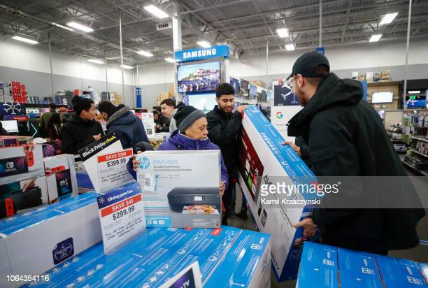 Shoppers pick out flat screen TVs at a Best Buy Inc store on November 22 2018 in Chicago Illinois Known as 'Black Friday' the day after Thanksgiving...