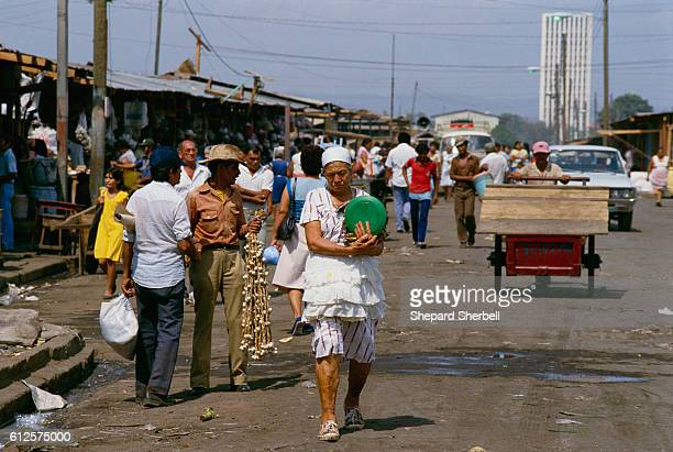 Shoppers purchase goods at an outdoor market in Managua Nicaragua's capital city Rising to power within the Nicaraguan government in the 1980s the...