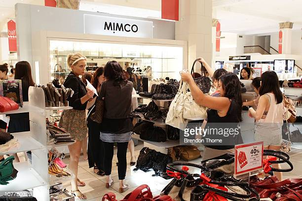 Shoppers purchase handbags during the Boxing Day sales at the David Jones Market Street store on December 26 2010 in Sydney Australia Retailers are...