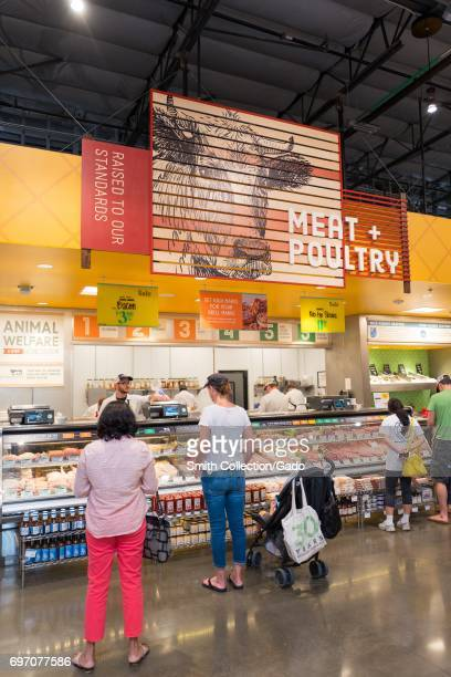 Shoppers purchase meat and poultry at Whole Foods Market grocery store in Dublin California June 16 2017 On June 16 Amazoncom announced that it would...