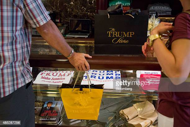 Shoppers purchase merchandise supporting Donald Trump president and chief executive of Trump Organization Inc and 2016 Republican presidential...