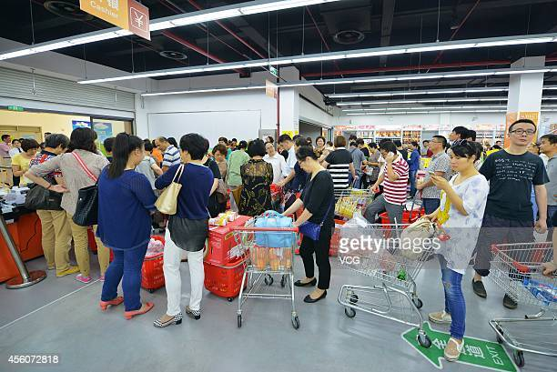 Shoppers purchase taxfree goods from an import commodity outlet center in Shanghai Free Trade Zone on September 25 2014 in Shanghai China