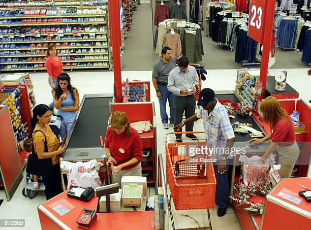 Shoppers purchase their items at the checkout counter in the Target department store at Sawgrass Mills Shopping Center November 19, 2001 in Sunrise,...