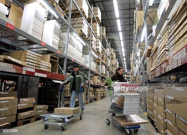 Shoppers push carts down one of the selfserve pickup aisles at a Ikea store January 27 2005 in Paramus New Jersey Ikea a Swedish company currently...