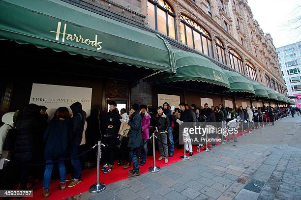 Shoppers queue ahead of the opening of the Boxing Day sale at Harrods on December 26 2013 in London England