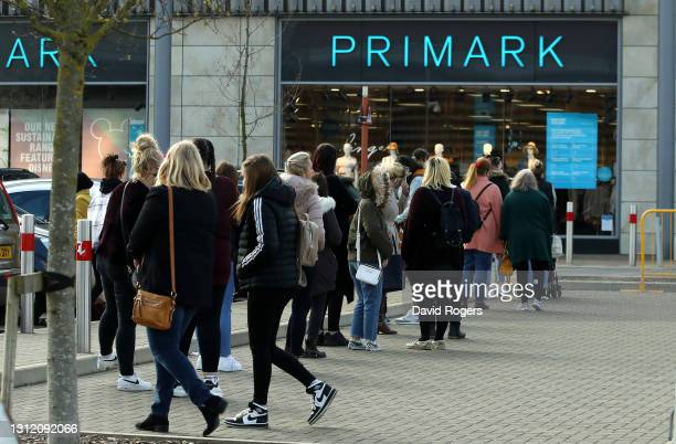 Shoppers queue at Rushden Lakes Centre on April 12, 2021 in Rushden, Northamptonshire, United Kingdom. England has taken a significant step in easing...