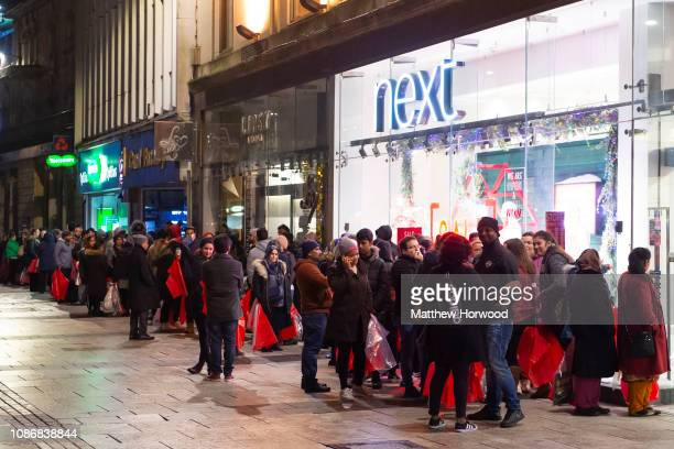 Shoppers queue at the Next Boxing Day sale at the Next store on Queen Street in Cardiff Wales on December 26 2018 in Cardiff United Kingdom Over 500...