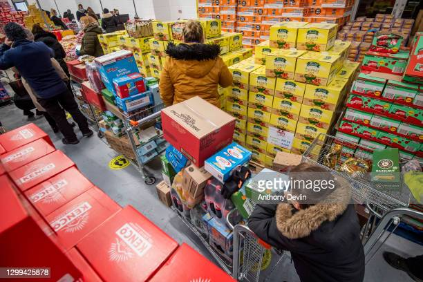Shoppers queue at the tills during the opening day of Rogers Wholesale, a supermarket which only sells food that's past its Best Before date on...