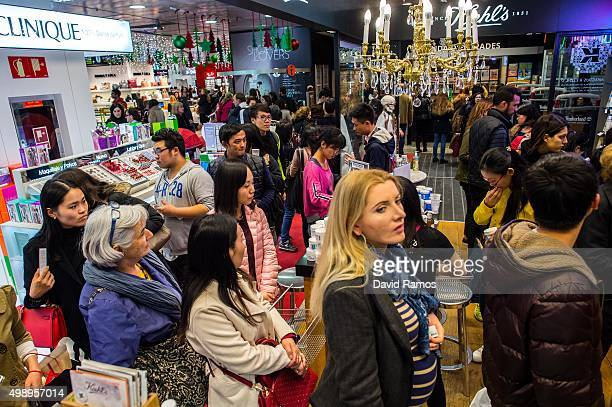 Shoppers queue in line to pay inside El Corte Ingles department store during 'Black Friday' discounts on November 27 2015 in Barcelona Spain...
