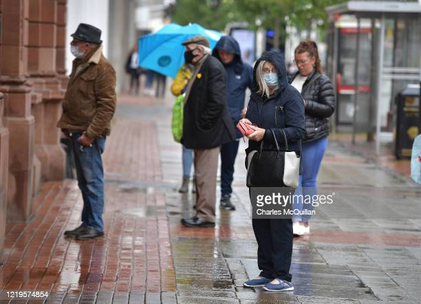 Shoppers queue in the High Street on June 12 2020 in Belfast Northern Ireland After being shuttered for months to curb the spread of Covid19...