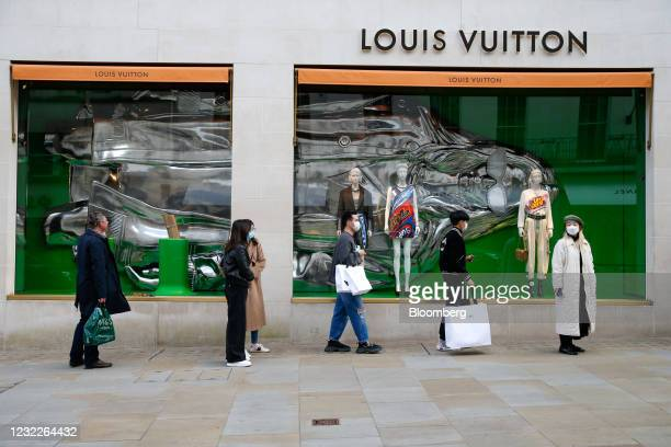 Shoppers queue outside a Louis Vuitton luxury goods store, operated by LVMH Moet Hennessy Louis Vuitton SE, in London, U.K., on Monday, April 12,...