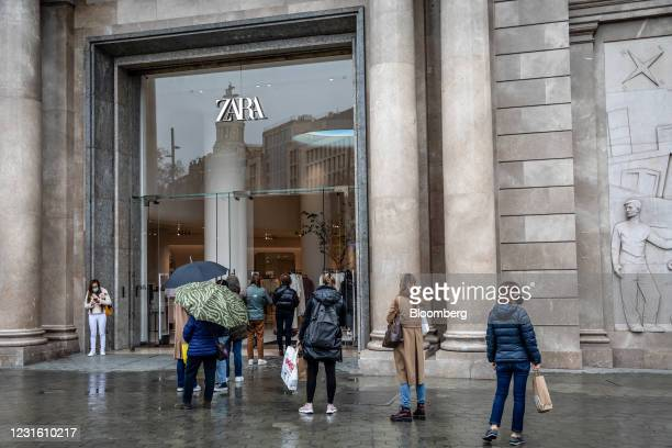 Shoppers queue outside a Zara clothing store, operated by Inditex SA, in Barcelona, Spain, on Monday, March 8, 2021. Inditex will report its annual...