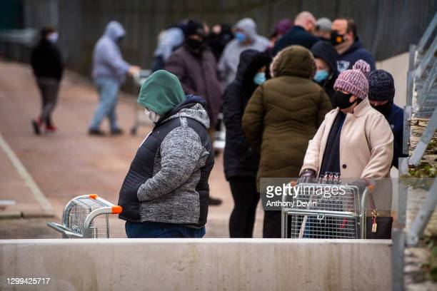 Shoppers queue outside during the opening day of Rogers Wholesale, a supermarket which only sells food that's past its Best Before date on January...