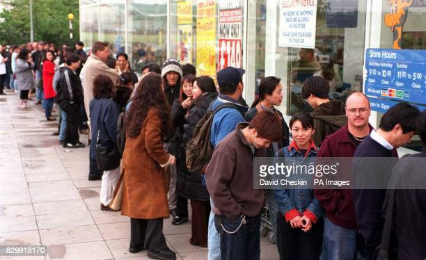 Shoppers queue outside London's Brent Cross ToysRUs this morning in the hope of buying a Tamagotchi virtual pet which celebrate their British launch...