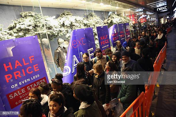 Shoppers queue outside Next ahead of the Boxing Day sales on December 26 2015 in London England Boxing Day is one of the busiest days for retail...