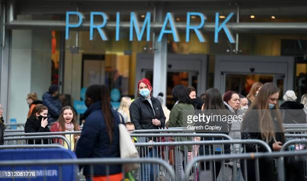 Shoppers queue outside Primark clothes shop on April 12, 2021 in Stoke on Trent, United Kingdom. England has taken a significant step in easing its...