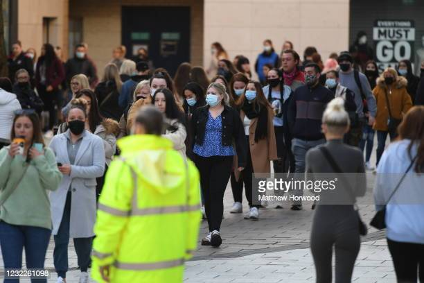 Shoppers queue outside Primark from 7am as non-essential retail reopens on April 12, 2021 in Cardiff, Wales. Lockdown restrictions have been eased...