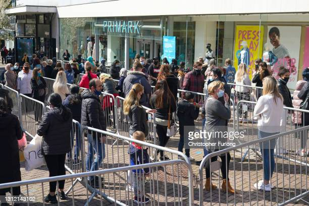 Shoppers queue outside Primark store on April 12, 2021 in Stoke on Trent, United Kingdom. England has taken a significant step in easing its lockdown...