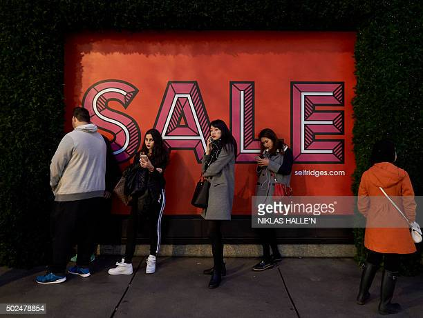 Shoppers queue outside Selfridges department store in central London on December 26 in the postChristmas Boxing Day sales AFP PHOTO / NIKLAS HALLE'N...