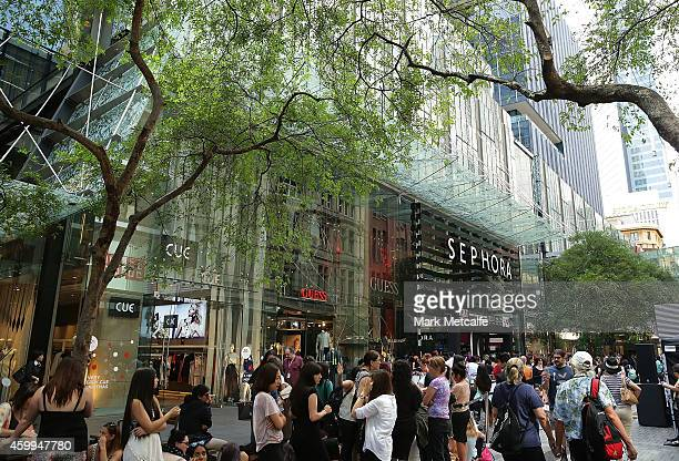 Shoppers queue outside Sephora before it opens the doors to its Westfield Pitt Street Mall store on December 5 2014 in Sydney Australia This is the...