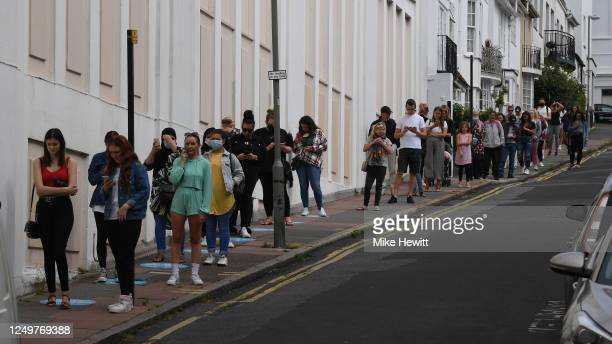Shoppers queue round the block for Primark on June 15, 2020 in Brighton, United Kingdom. The British government have relaxed coronavirus lockdown...