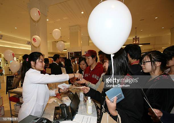Shoppers queue to make purchases during the David Jones boxing day clearance sale at the Bourke Street Mall flagship store on December 26 2010 in...