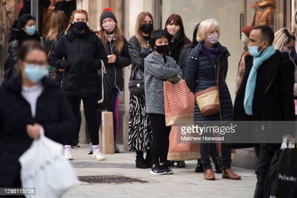 Shoppers queuing for a Zara store on Black Friday on November 27, 2020 in Cardiff, Wales. Restrictions across Wales have been relaxed following a...