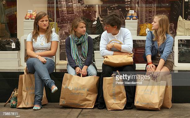 Shoppers rest after a visit to the newly opened Primark clothing store on Oxford Street on April 11 2007 in London England Police were called on the...