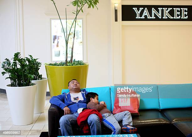 Shoppers rest on a couch at the North County Fair Mall on November 27 2015 in Escondido California Although Black Friday sales are expected to be...
