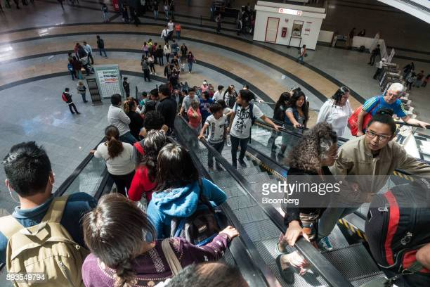 Shoppers ride an escalator at the Forum Buenavista mall in Mexico City Mexico on Monday Nov 20 2017 The National Institute of Statistics and...